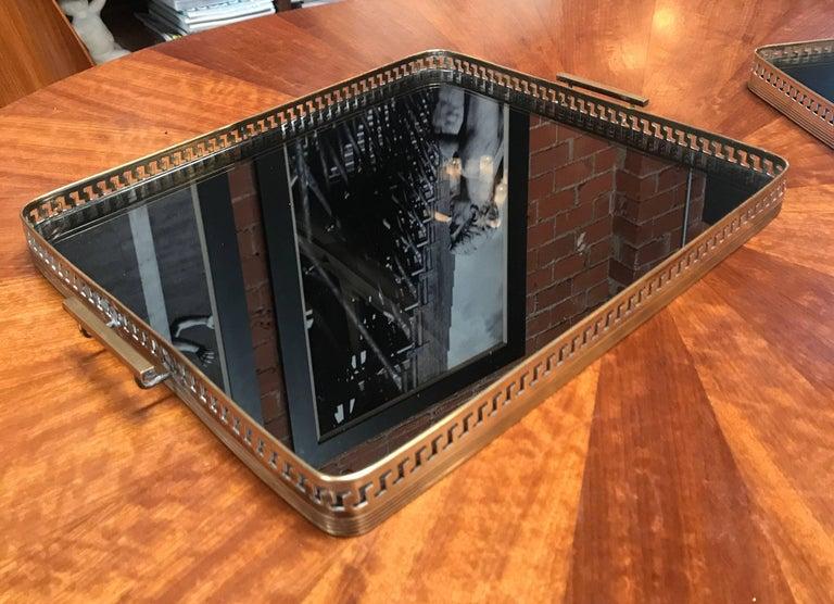 Beautiful Italian brass tray, brass shaped base with smoke mirror glass top.