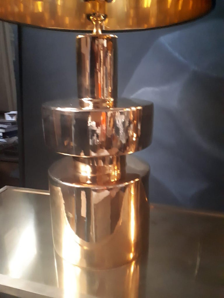 Pair of elegant lamps, with brass base, Italian production of the 1970s. The measures with the hat are: H 80 cm D 40 cm  The measure of the base is: H 54 cm D 27 Cm.