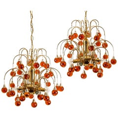 Pair of Brass Orange and Red Four Tiers Murano Chandeliers, 1970s