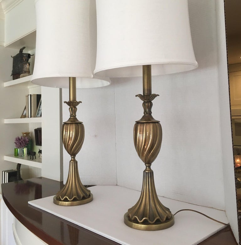 Pair of brass Rembrandt table lamps.