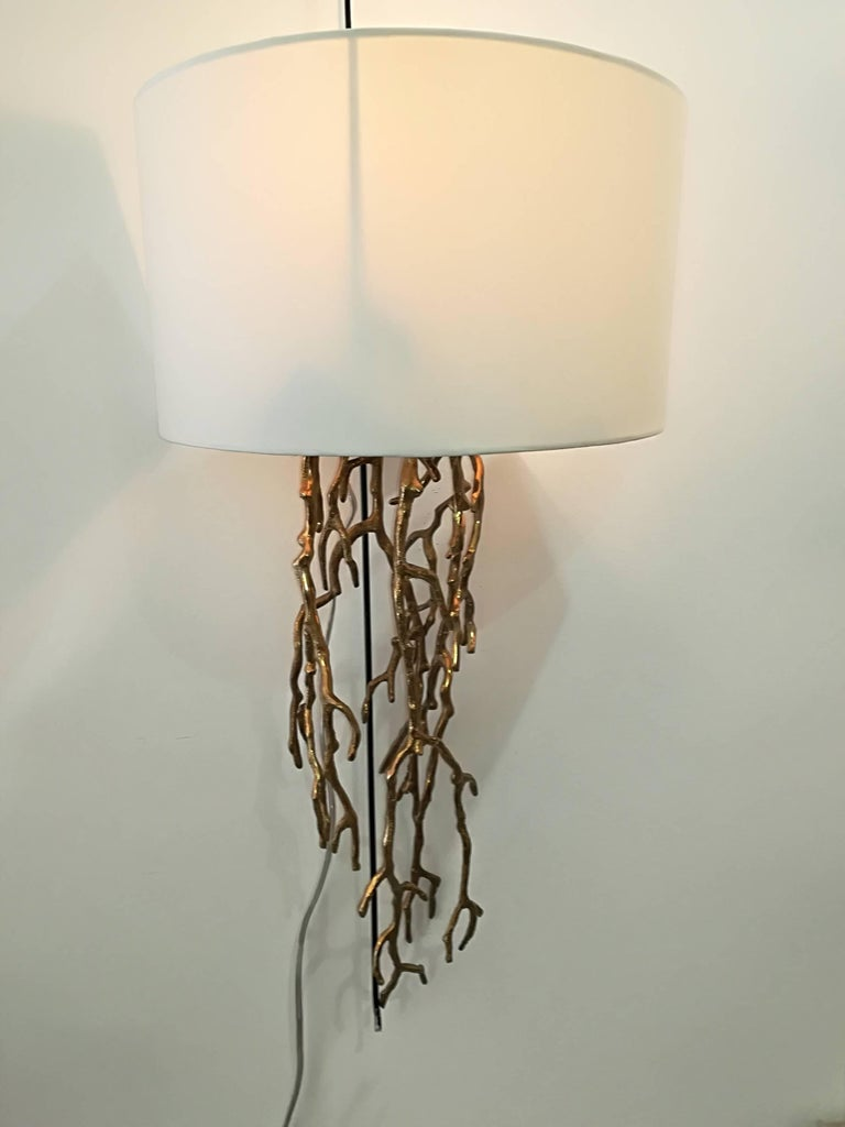 Pair of sconces, provided with elegant white lampshades.