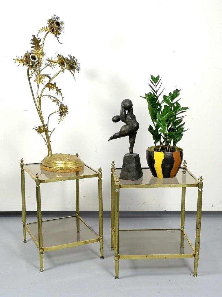 Modern empire style, the brass side tables are vintage pieces from the 1970s.