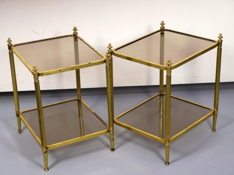 Hollywood Regency Pair of Brass Side Table with Smoke Glass Shelves, Empire Style, 1970s For Sale