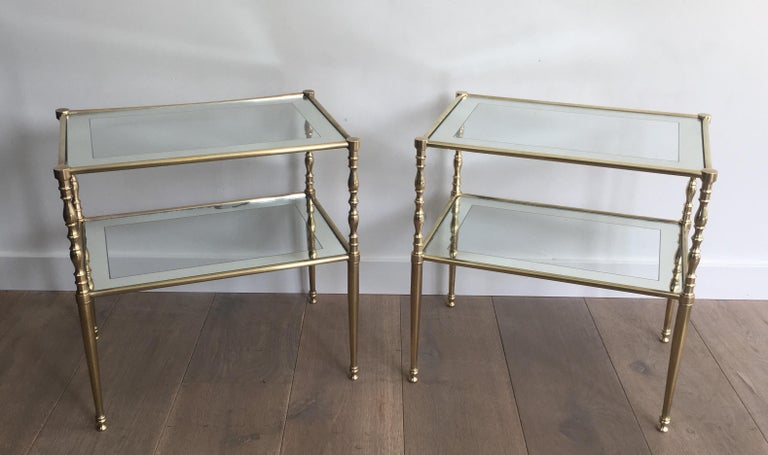 French Pair of Brass Side Tables with Clear Glass Shelves Surrounded by Silvered Mirror For Sale