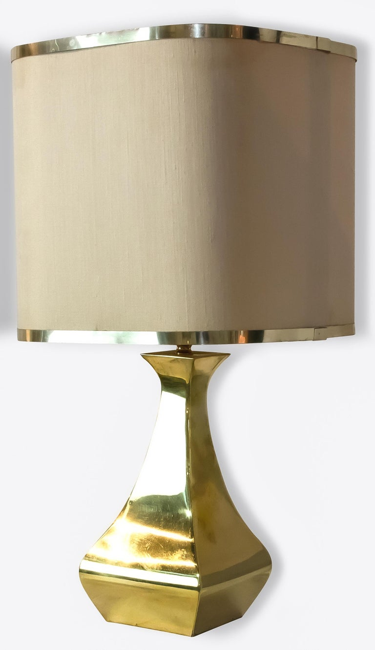 Pair of table lamp is an original design lamp realized by the designers A. Tonello and A. Montagna Grillo circa 1970s.  Very beautiful couple of table lamp made of brass.  Dimensions: cm 45 (height) x 25 (diameter)  Very good conditions.