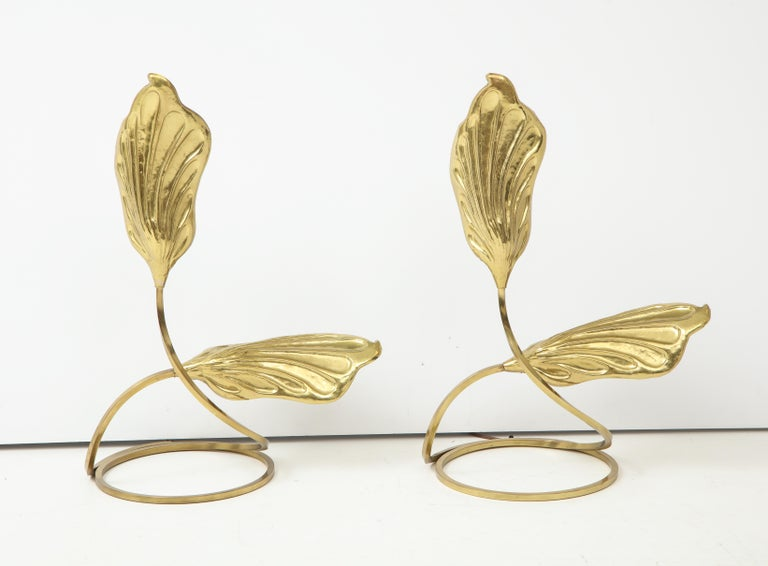 Pair of brass table lamps by Tomasso Barbi stylized leaves curve up from a circular base.