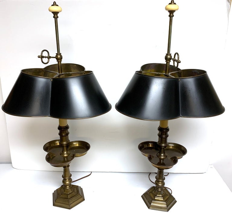 Pair of brass and tole clover bouillotte lamps, by Chapman, each one of typical form standing 32-Inches high with adjustable 15