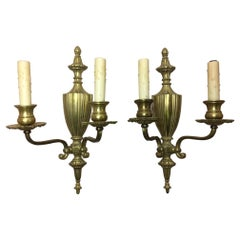 Pair of Brass Two-Light Urn and Finial Top Sconces, 20th Century