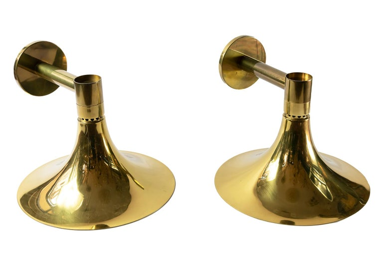 Pair of wall light sconces made of brass with inside surface in white color. Bulbs are E27 (1 pieces in each sconce).