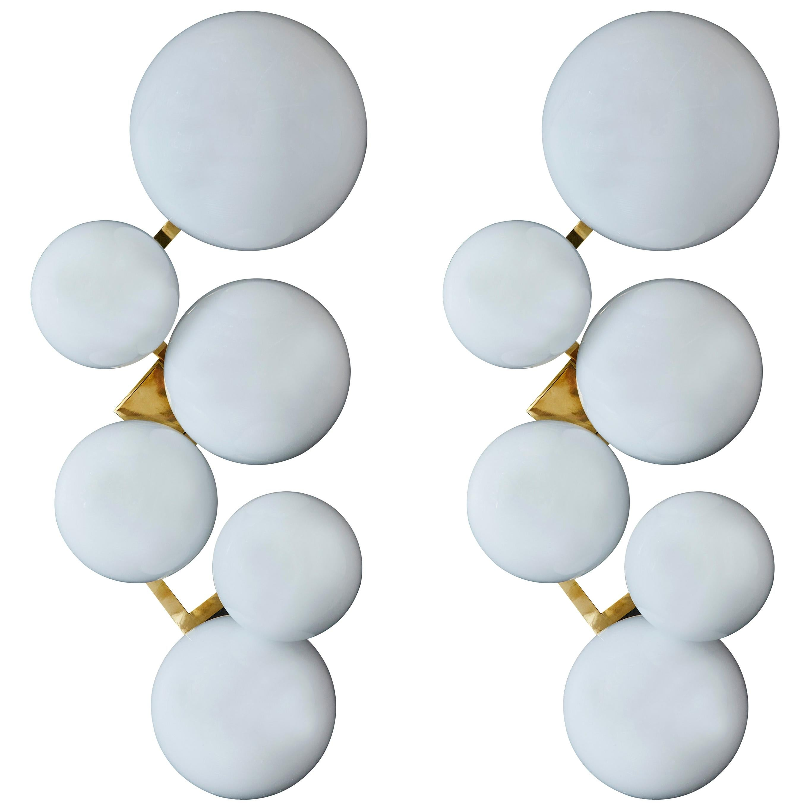 Pair of Brass Wall Sconces with Different Sized White Glass Globes