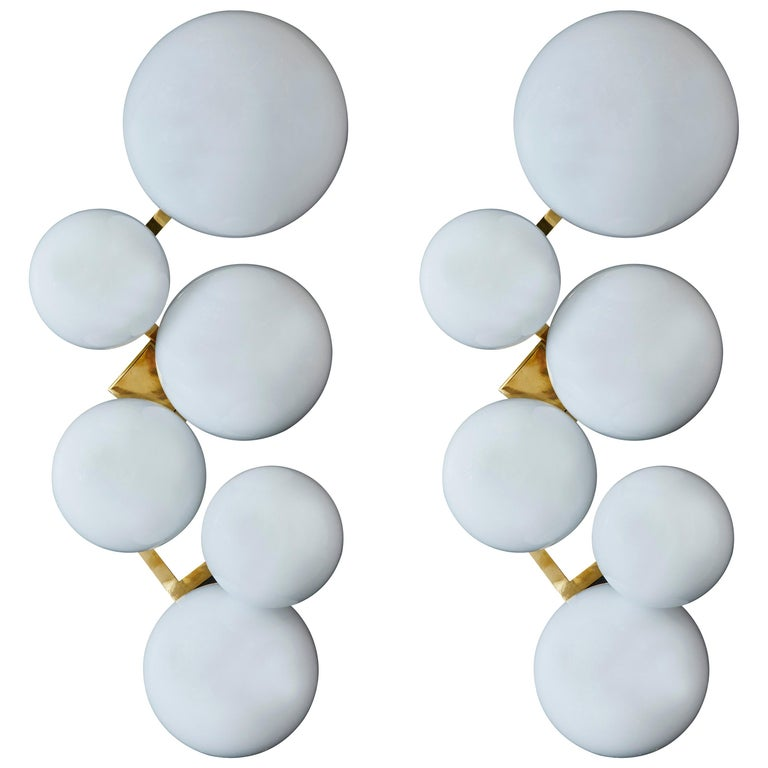 Pair of Brass Wall Sconces with Different Sized White Glass Globes For Sale