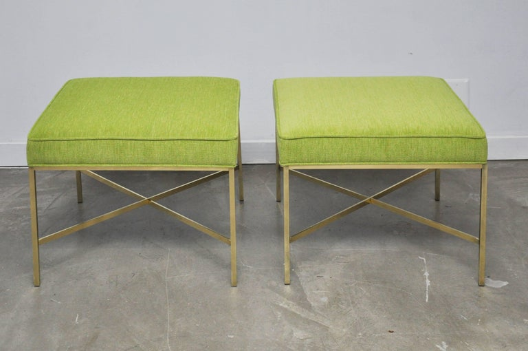 Pair of brass X-base stools Paul McCobb for Calvin Furniture. New cushions and upholstery over polished brass bases.