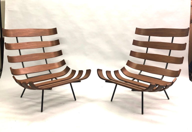 Pair of Brazilian Mid-Century Modern 'Costela' Armchairs / Lounge Chairs by Carlo Hauner and Martin Eisler, circa 1954.   Black enameled steel frame, tiny brass finial feet and curved Brazilian Rosewood ribbed structure. The iconic Brazilian rib