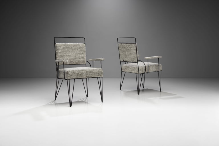 This imposing pair of Brazilian armchairs in iron and fabric is a visually stunning representation of Brazilian Modern design. The well thought out minimalism of these armchairs is honest, elegant and comfortable.  The pair is defined by geometric