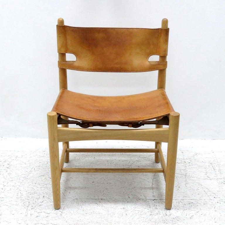Wonderful pair of Børge Mogensen 'Hunting' chairs, model no. 3237 for Fredericia Furniture, with saddle leather on oak frames, great patina.