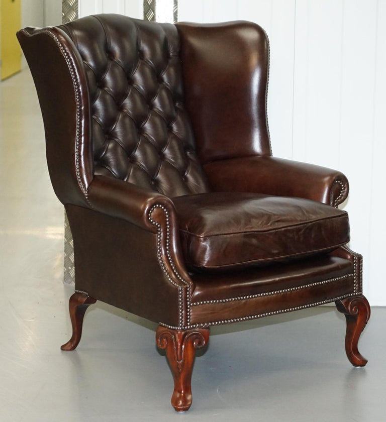 We are delighted to offer for sale this stunning pair of Brights of Nettlebed RRP £5000 handmade Chesterfield Coleridge very heavy brown leather wingback armchairs with ornately carved cabriolet legs and feather filled cushions  The Coleridge wing