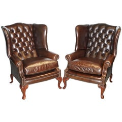 Pair of Brights of Nettlebed Chesterfield Brown Leather Wing Armchairs