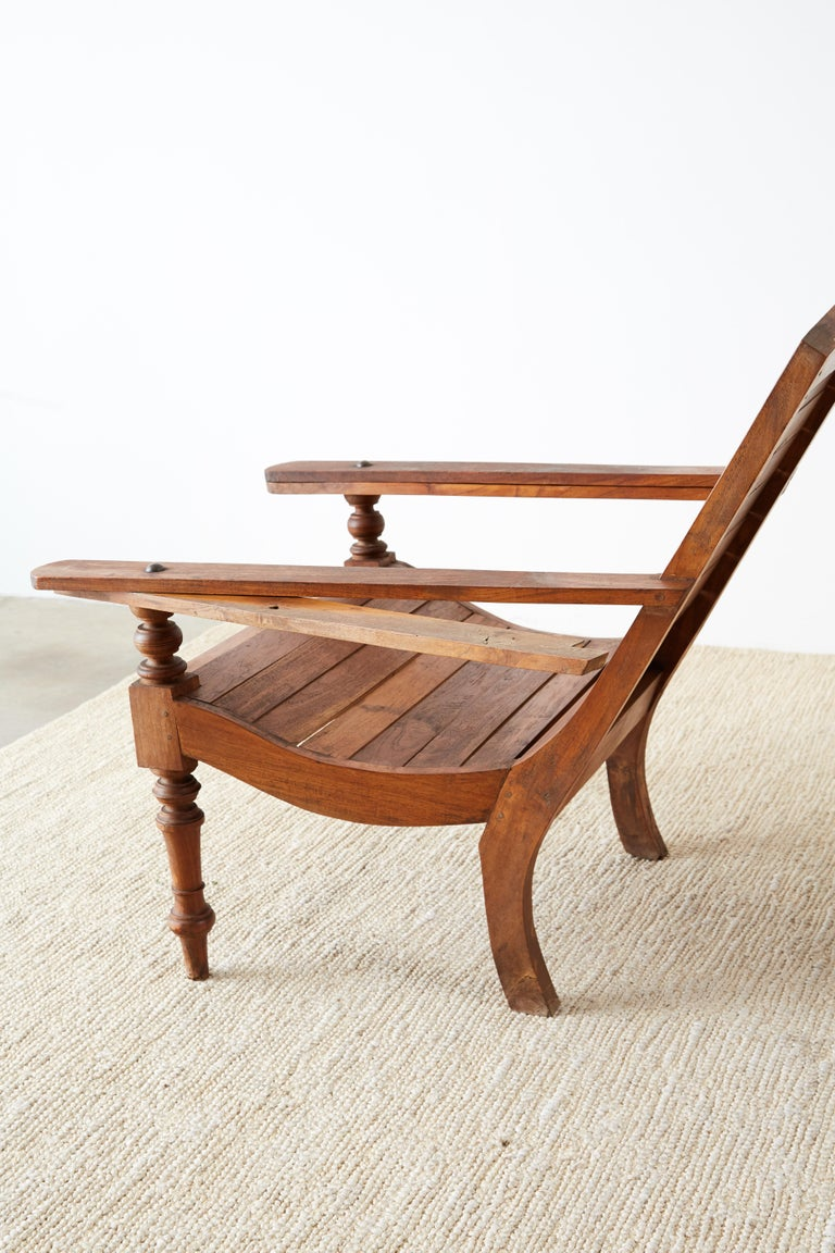 Pair of British Colonial Teak Plantation Chairs For Sale 9