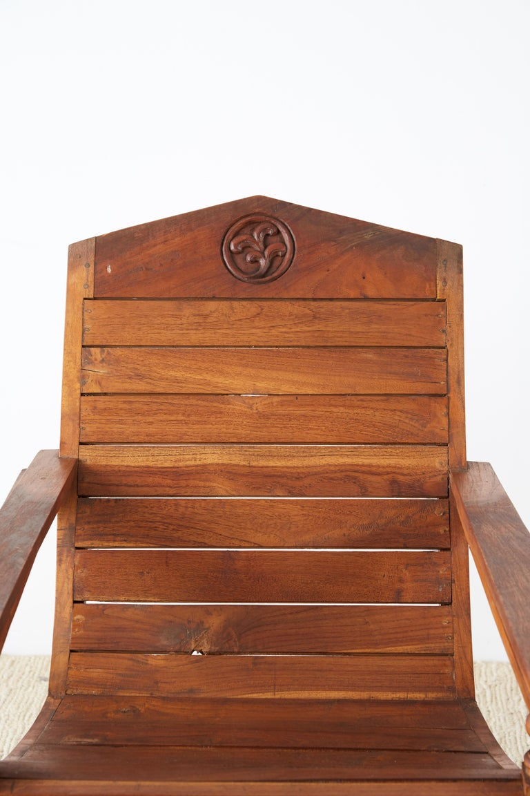 20th Century Pair of British Colonial Teak Plantation Chairs For Sale
