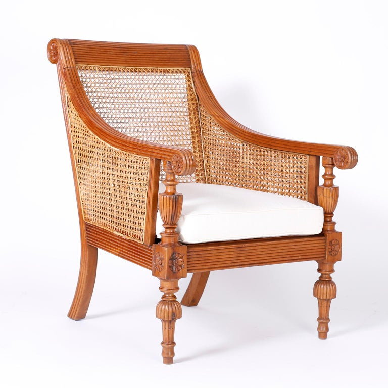 Pair of antique Anglo-Indian matching armchairs. Crafted in teak wood with pegged construction carved and beaded frames, with caned backs and seats and Classic carved, turned legs.