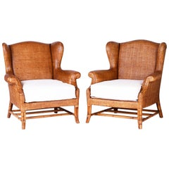 Pair of British Colonial Wicker and Bamboo Wing Chairs by Baker