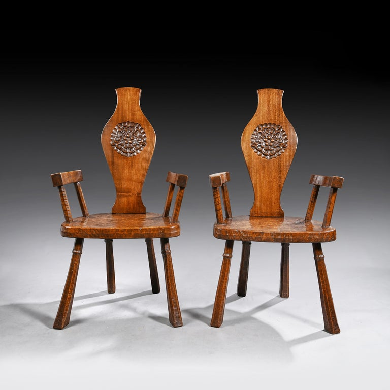 A very good pair of British oak and pollard oak country armchairs by Jack Grimble of Cromer   English, circa 1940-1950  Of excellent color, these distinctive and fine quality chairs are partly inspired by the Arts & Crafts furniture of the late