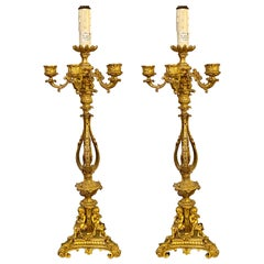 Pair of Bronze 1920s Electrified Candelabra Lamps, Full Figure Fluted Cherubs