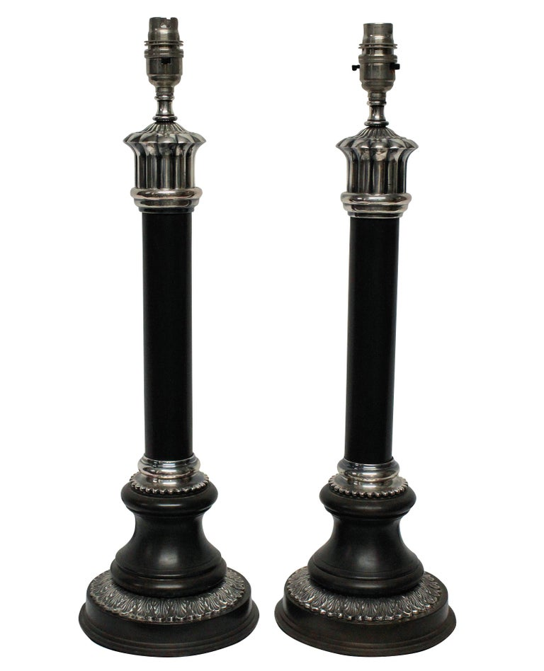 A pair of English bronzed and silver plated neoclassical column table lamps.