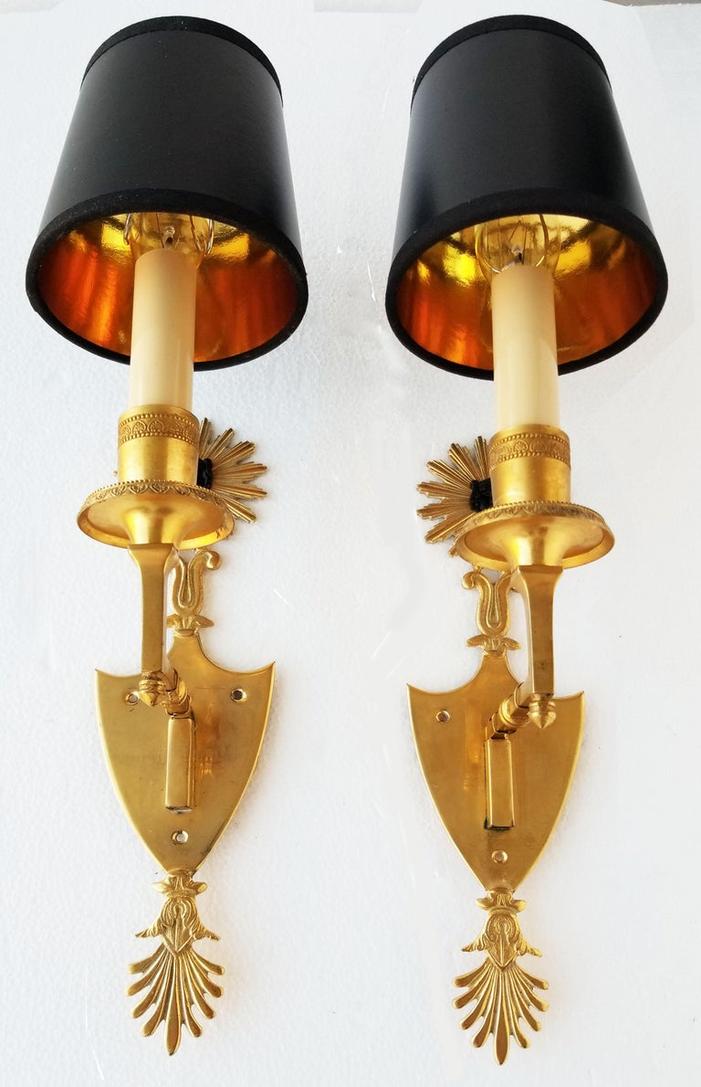 Superb pair of Andre Arbus style sconces in doré bronze. 1 light, 40, watts max bulb. US rewired and in working condition  Measurements without black paper shades: 5