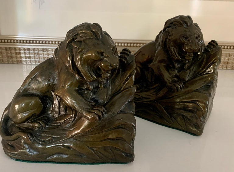 A wonderful and heavy pair of Lion bookends - clad in bronze finish, the bookends are by RUHL and a compliment to any desk or bookshelf.