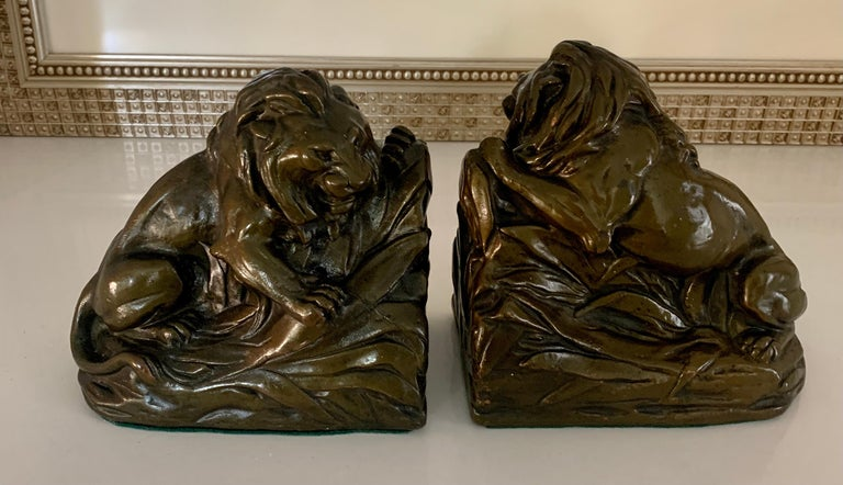 Rustic Pair of Bronze Clad Lion Bookends For Sale