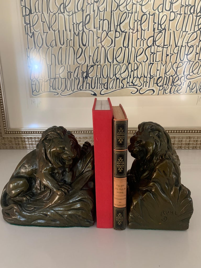 20th Century Pair of Bronze Clad Lion Bookends For Sale