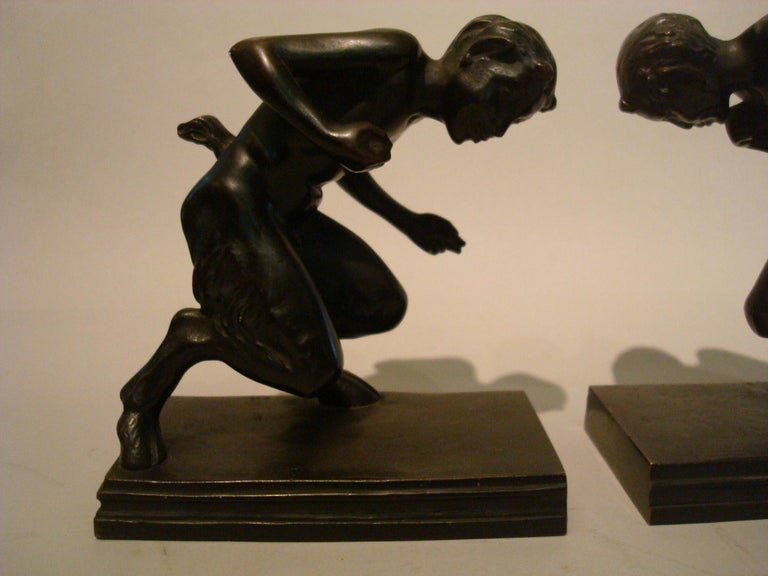 Pair of bronze Faun figures bookends, Austrian, early 20th century, attractive patina, one stamped with a very small triangular foundry mark. Very nice pair of sculptures.