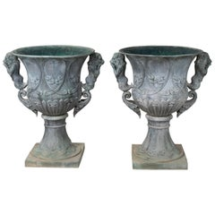 Pair of Bronze Garden Urns with Lions in Old Green Patina