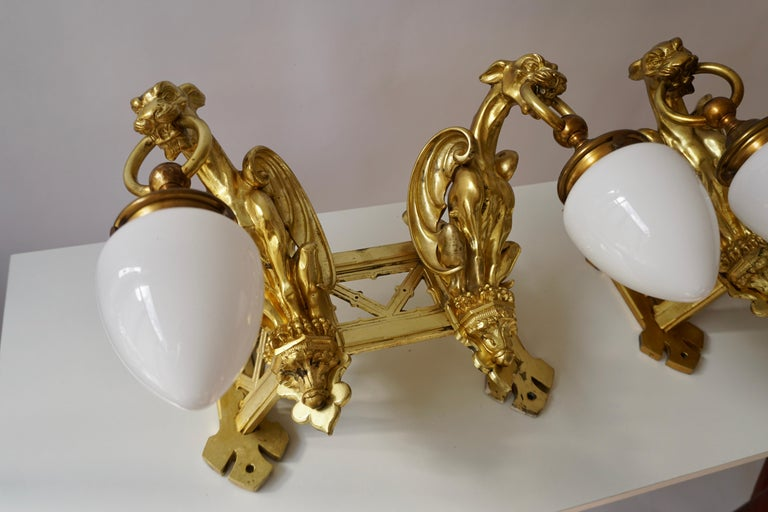 Pair of Bronze Gilt and Glass Wall Sconces Representing Two Griffins For Sale 3
