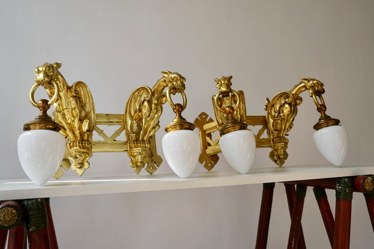 Pair of Bronze Gilt and Glass Wall Sconces Representing Two Griffins For Sale 10