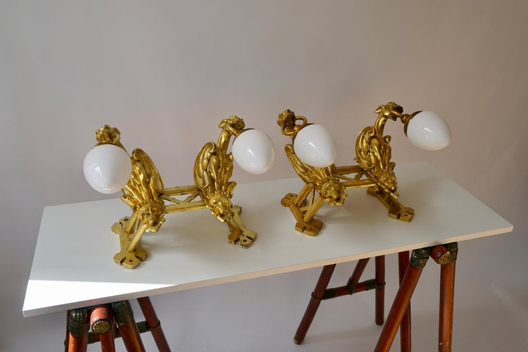 Pair of Bronze Gilt and Glass Wall Sconces Representing Two Griffins For Sale 1