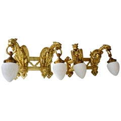 Pair of Bronze Gilt and Glass Wall Sconces Representing Two Griffins