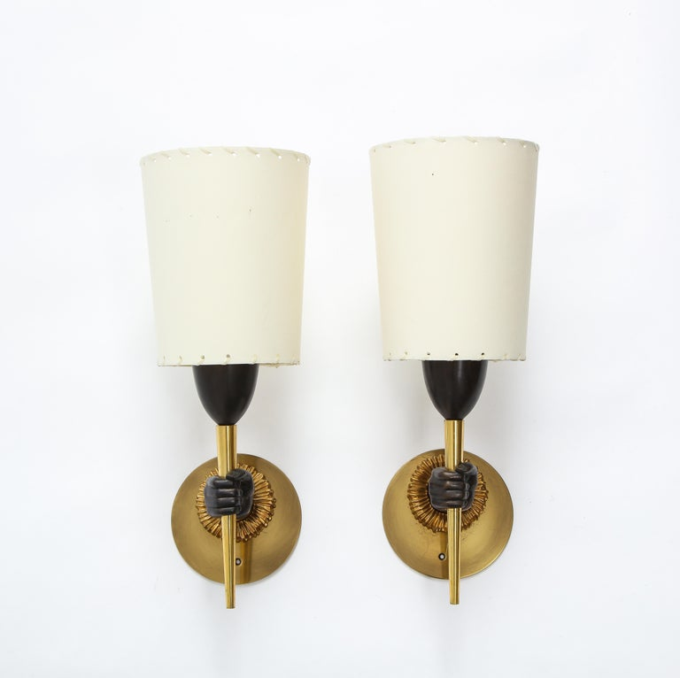 Dual patina bronze hand sconces by Jansen, the hand although not life-size is highly detailed on a sun patterned mount. Rewired with custom backplates.