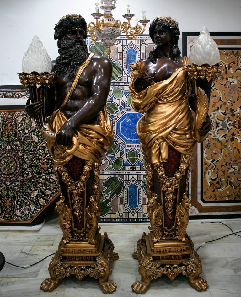 Pair of large tall lampers representing Zeus and his wife Hera, cast in bronze, hand painted and varnished.   The apex of interior decoration.