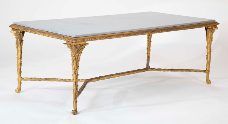 A magnificent pair of finely chased bronze coffee tables with grey marble tops.