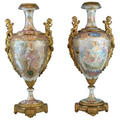 Pair of Bronze Mounted Sèvres-Style Polychrome and Gilt Porcelain Vase