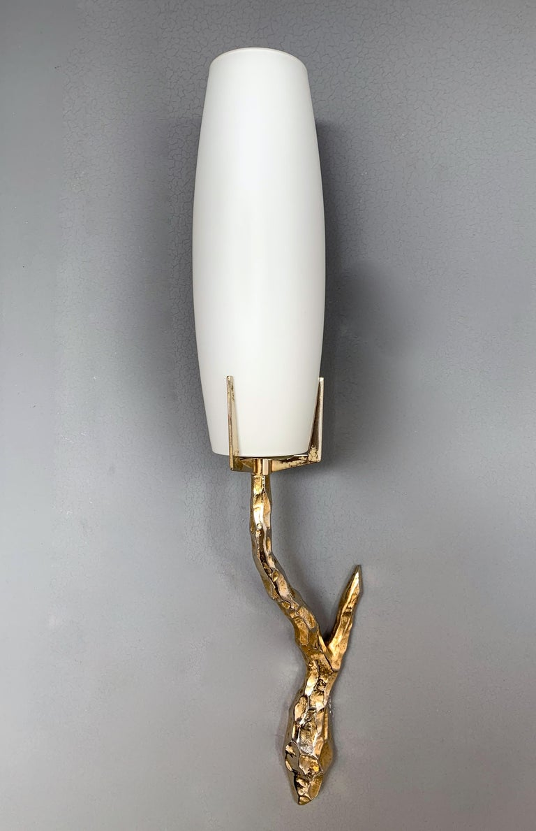 Pair of wall lights sconces cast gilt bronze and opaline glass diffusor by Maison Arlus, very interesting and sculptural model based on Felix Agostini drawing for the manufacture. On request original Arlus advertising from the 1960s. It's a famous