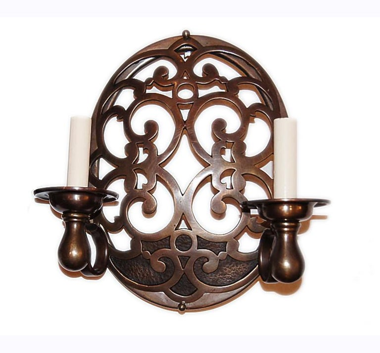 Pair of 1920s Italian double light open-work patinated bronze sconces.  Measurements: Height 13