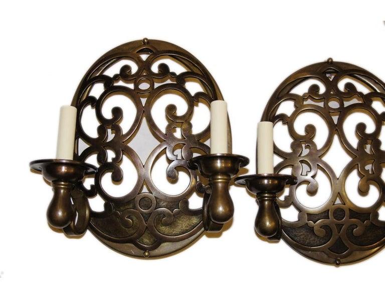 Italian Pair of Bronze Sconces For Sale