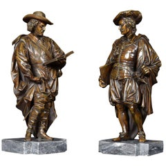 Pair of Bronzed Figures on Marble Bases