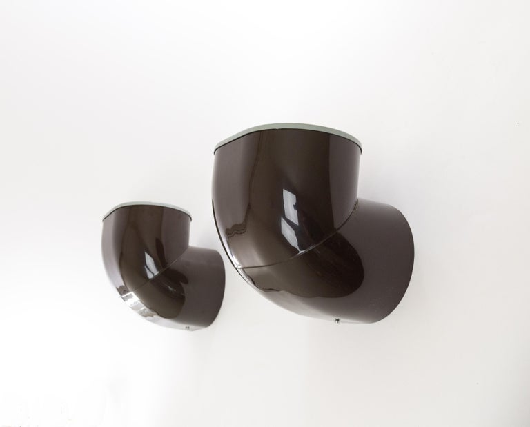 A pair of Gomito wall Lamps, one of the lesser known lighting designs by architect Gae Aulenti for Stilnovo.  The model consists of a brown plastic base and a grey lacquered basin containing a tubular halogene bulb of max. 500 W.  Rare