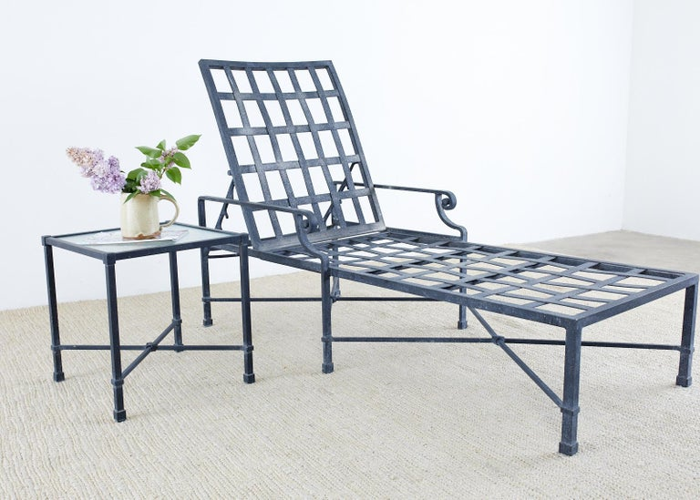 Stylish wrought aluminum patio and garden chaise lounges made by Brown Jordan. From the Neoclassical style Venetian collection featuring a lattice seat and adjustable back with decorative scrolled arms. The lounges have a powder coated multi step
