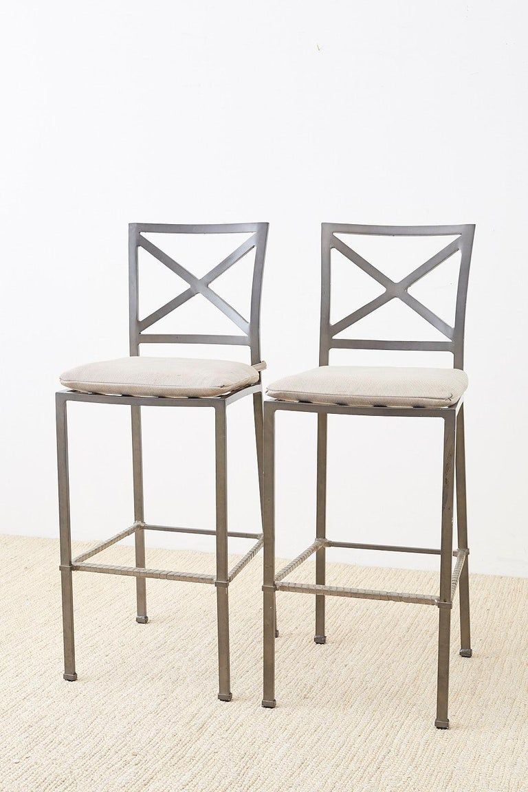 Powder-coated pair of patio garden barstools by Brown Jordan. Constructed from aluminum and finished in a grey color. Each chair has an X-motif square back and straight legs with a box stretcher footrest. Designed by Richard Frinier and known as the
