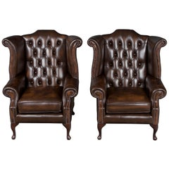 Pair of Brown Tufted Leather Wingback Armchairs